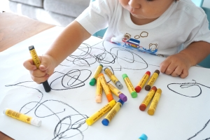 Canva - Kid Drawing with Crayons